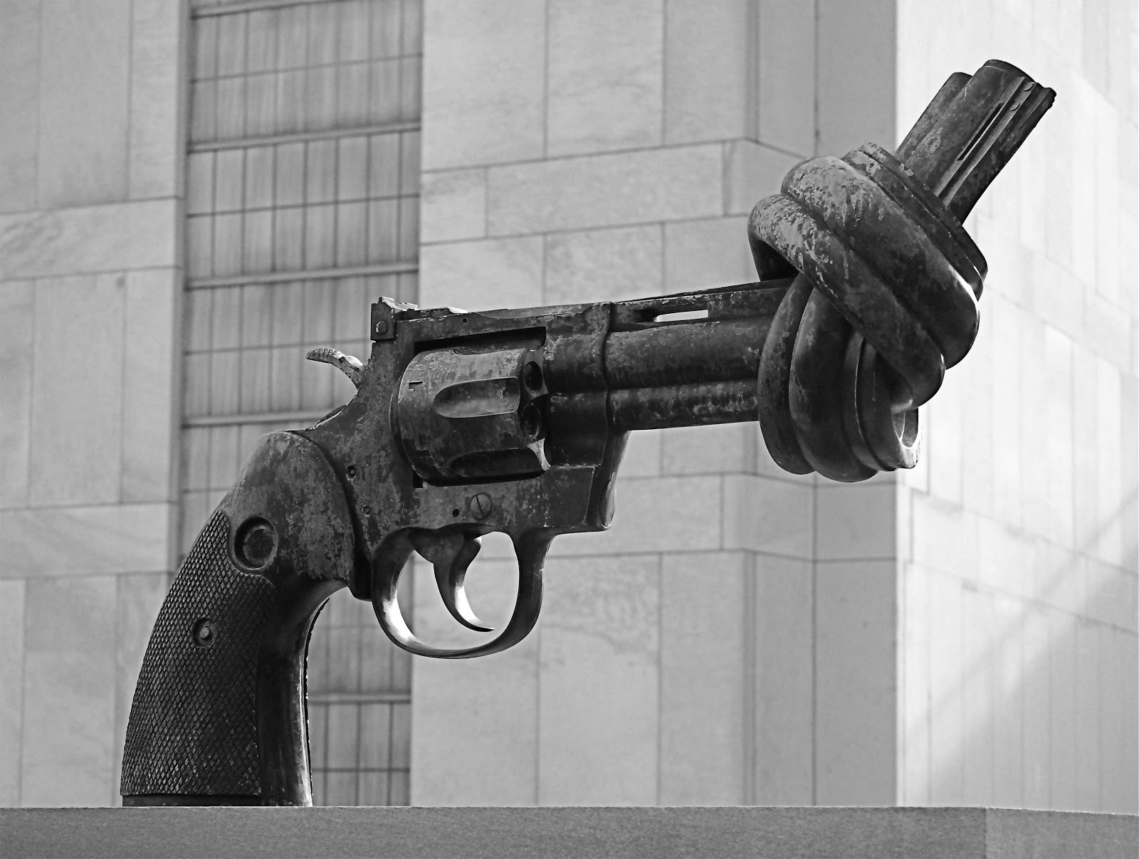 Image of a sculpture of a gun with its barrel tied in a knot.