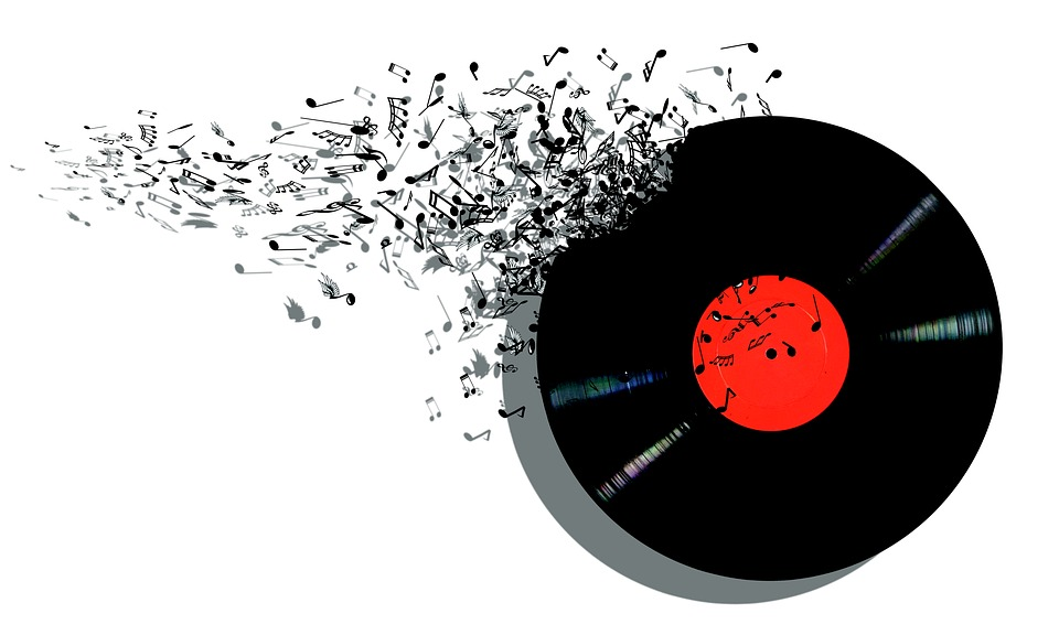 an image of a vinyl record breaking up into musical notes.