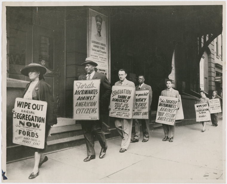 Paul Robeson joining members of the Baltimore chapter of the NAACP in a picket line in front of Ford's Theater, Baltimore.