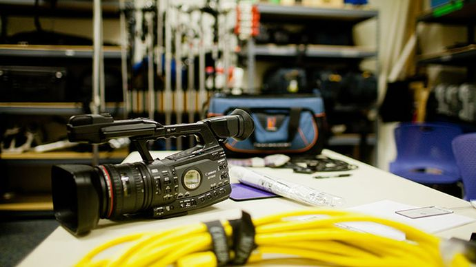 Photograph of camera equipment and related paraphernalia on a table.