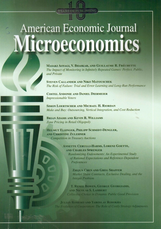 Journal Cover - Title in white lettering above a green image of a torch with a green gear behind it against a white to green gradient background.