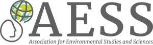 Logo - Text in grey lettering to the right of an image of a globe next to a human face in profile.