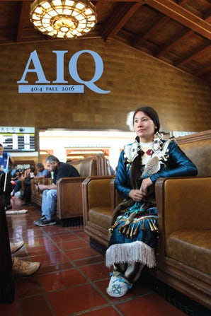 Journal Cover - Title in light blue lettering over a photograph of a young woman in traditional Native American attire sitting on a couch in a public space.