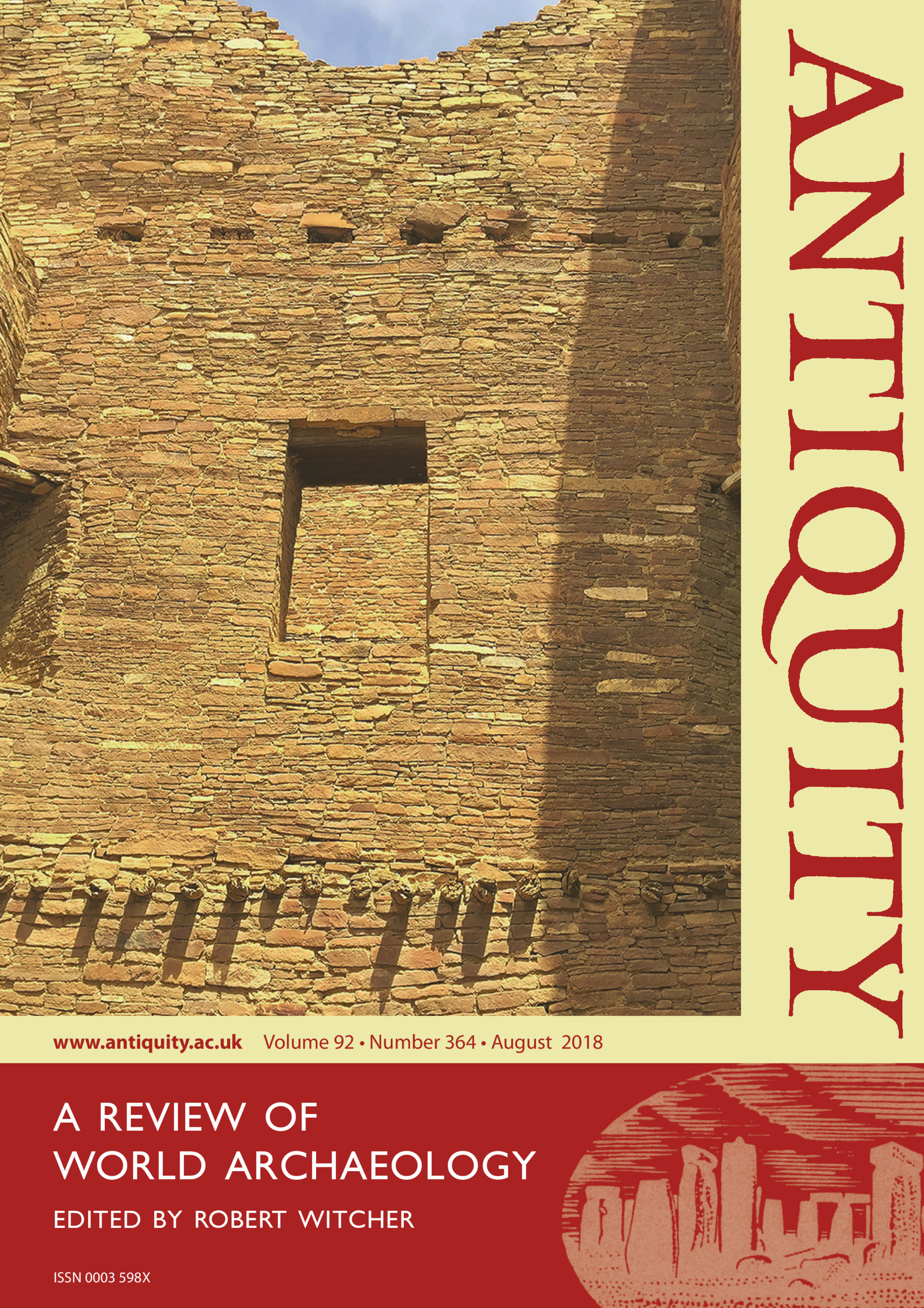 Journal Cover - Title in red lettering in a vertical, cream banner to the right of a photography of an ancient stone wall.