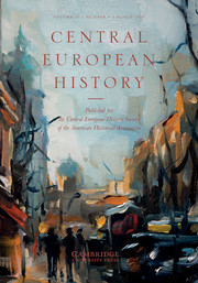 Journal Cover - Title in orange lettering over an impressionistic painting of a city street.