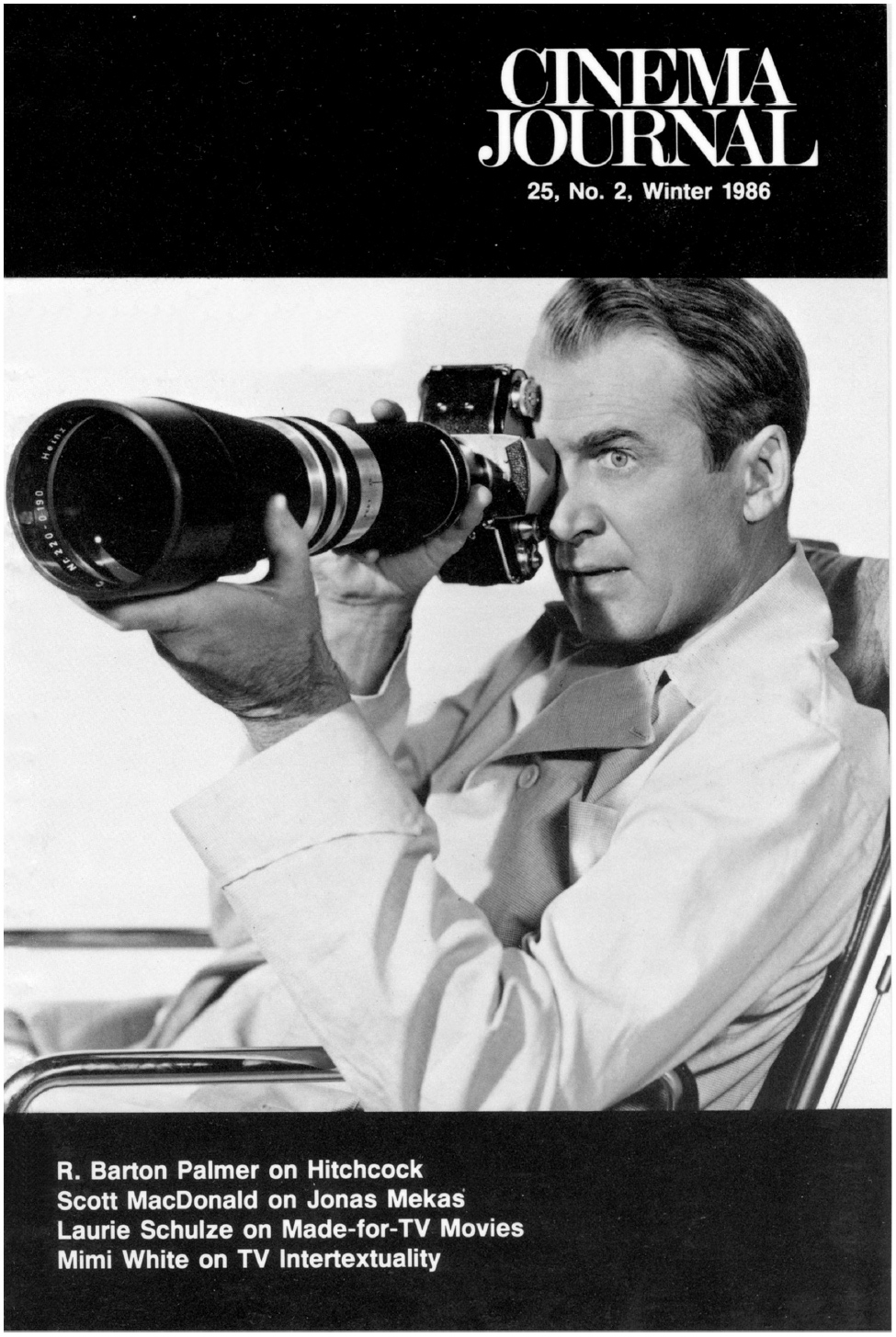 Journal Cover - Title in white lettering above a black and white photograph of a man looking through a camera with a very long lens against a black background.