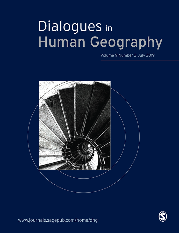 Journal Cover - Title in white and grey lettering above a black and white image of a spiral staircase against a dark blue background.
