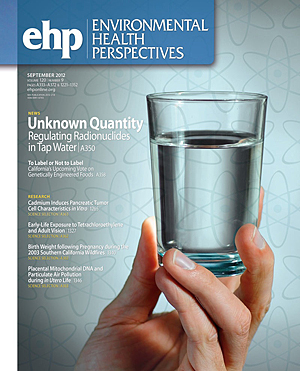 Journal Cover - Title in white lettering in a blue box over a photograph of a hand holding a glass of water up to the light.
