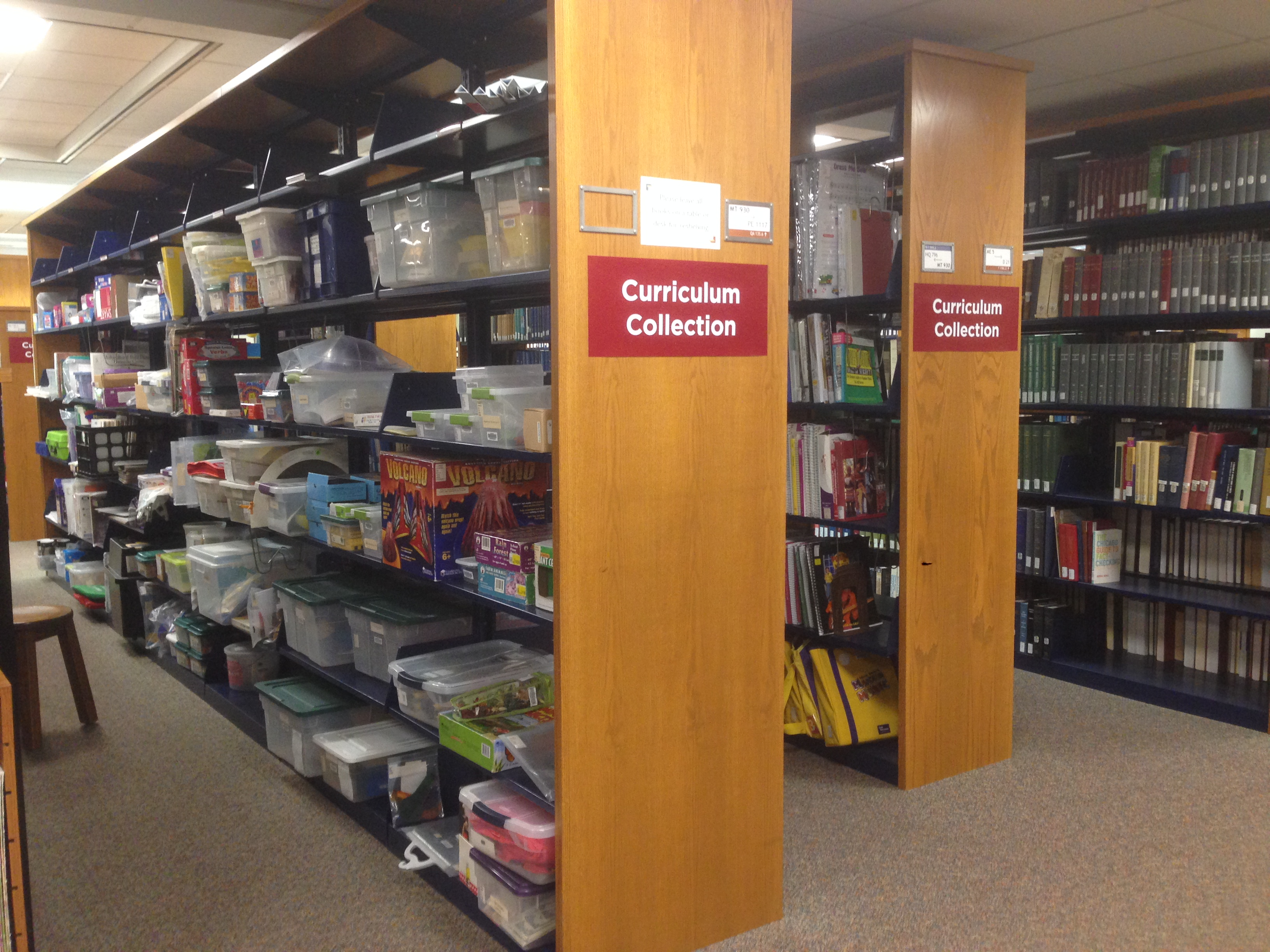 Photograph of the shelves of Hekman library's Curriculum Collection.
