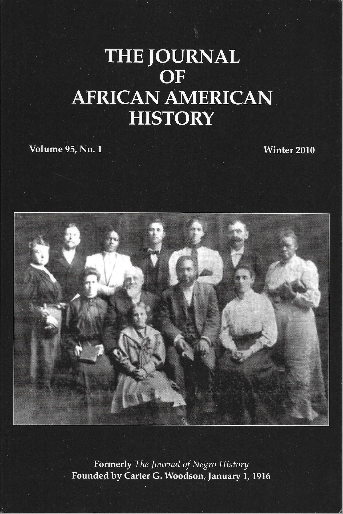 Journal Cover - Title in white lettering above and black-and-white photograph of a group of people against a black background.