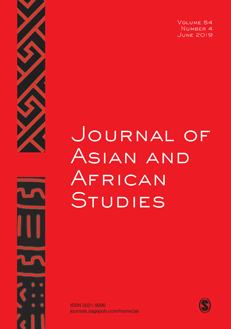 Journal Cover - Title in white lettering against a red background with a vertical black stripe with a pattern on it on the left.