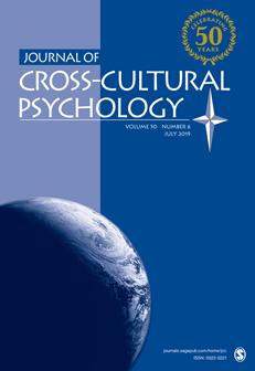Journal Cover - Title in white lettering above an image of the globe against a blue and lavender background.
