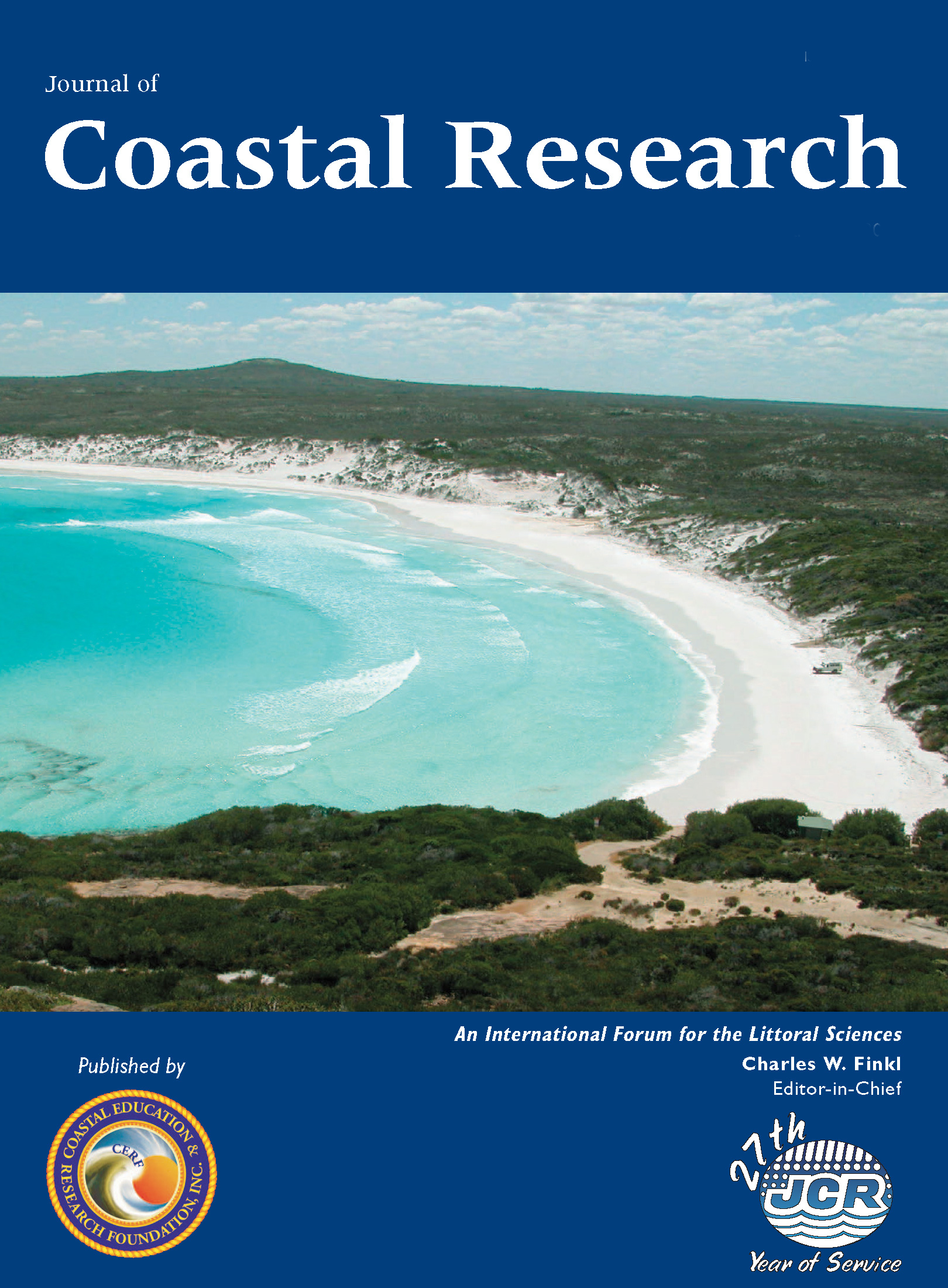 Journal Cover - Title in white lettering over a photograph of a white beach coastline against a dark blue background.