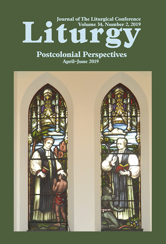Journal Cover - Title in light blue lettering above a photograph of two stained windows in a church against a green background.