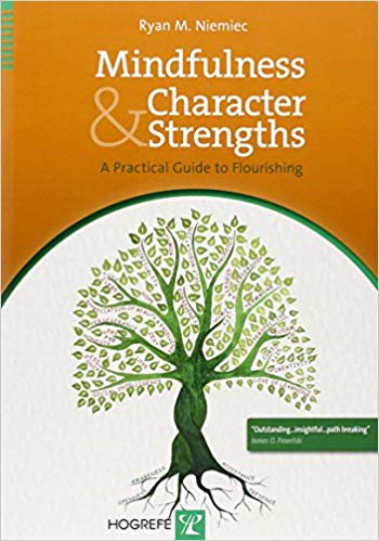 Book Cover - Title in white lettering against an orange background above a green illustration of a tree against a cream background.