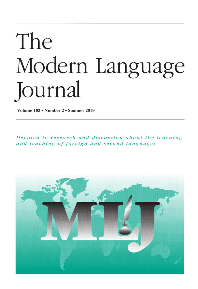 Journal Cover - Title in black lettering above a teal-colored map of the world with the letters MLJ over it in black-to-white gradient lettering.