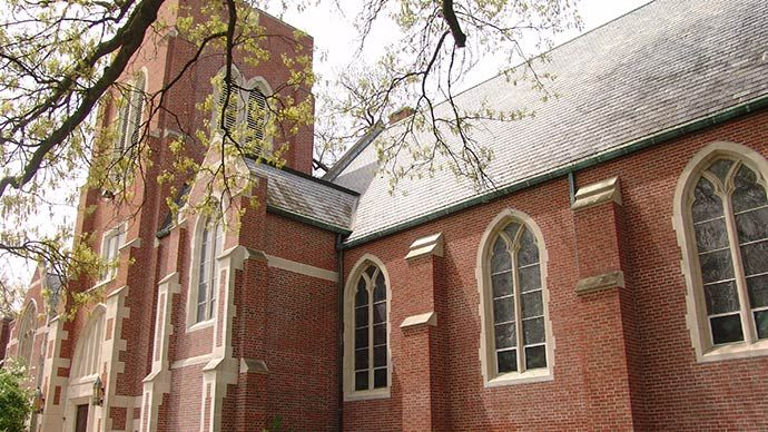 Photograph of the red-brick exterior of a small church.