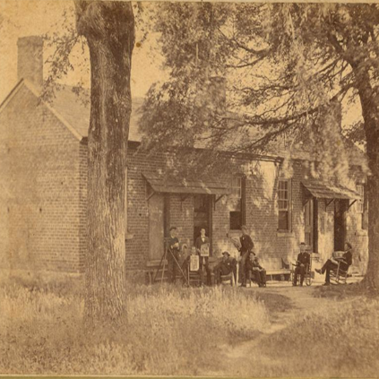 Students in Front of Elm Row Image from College