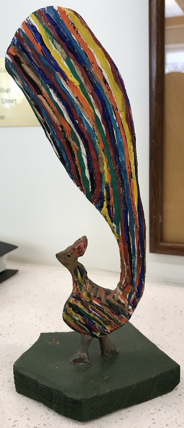 image of carved and painted bird - other side