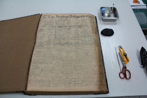 Newspaper with conservation tools