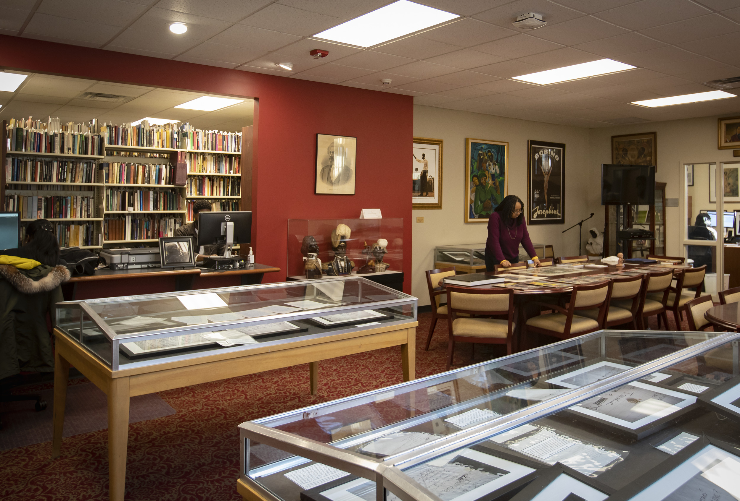 Women looking at materials in reading room of Blockson Collection