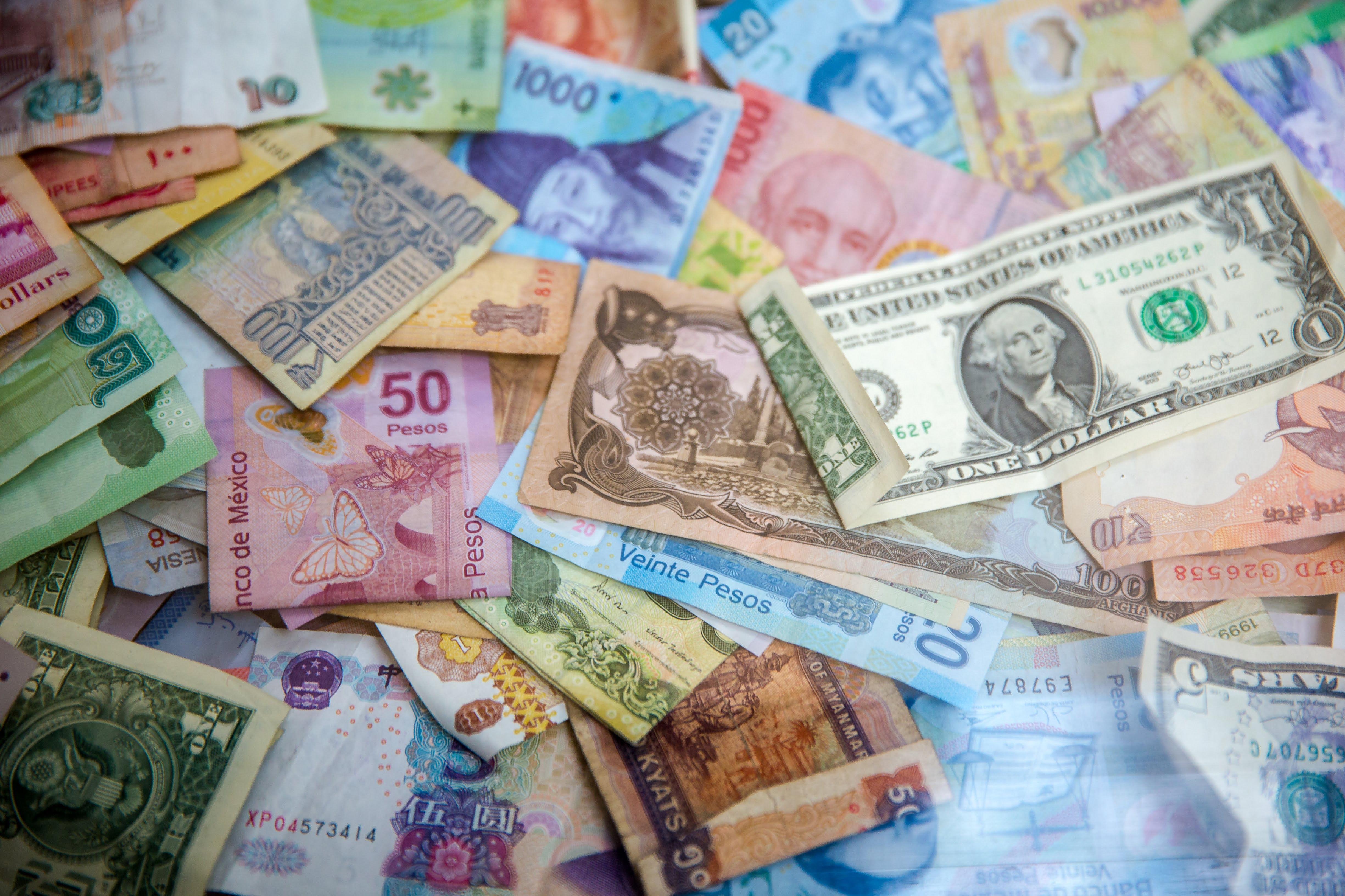 pile of money in different currencies