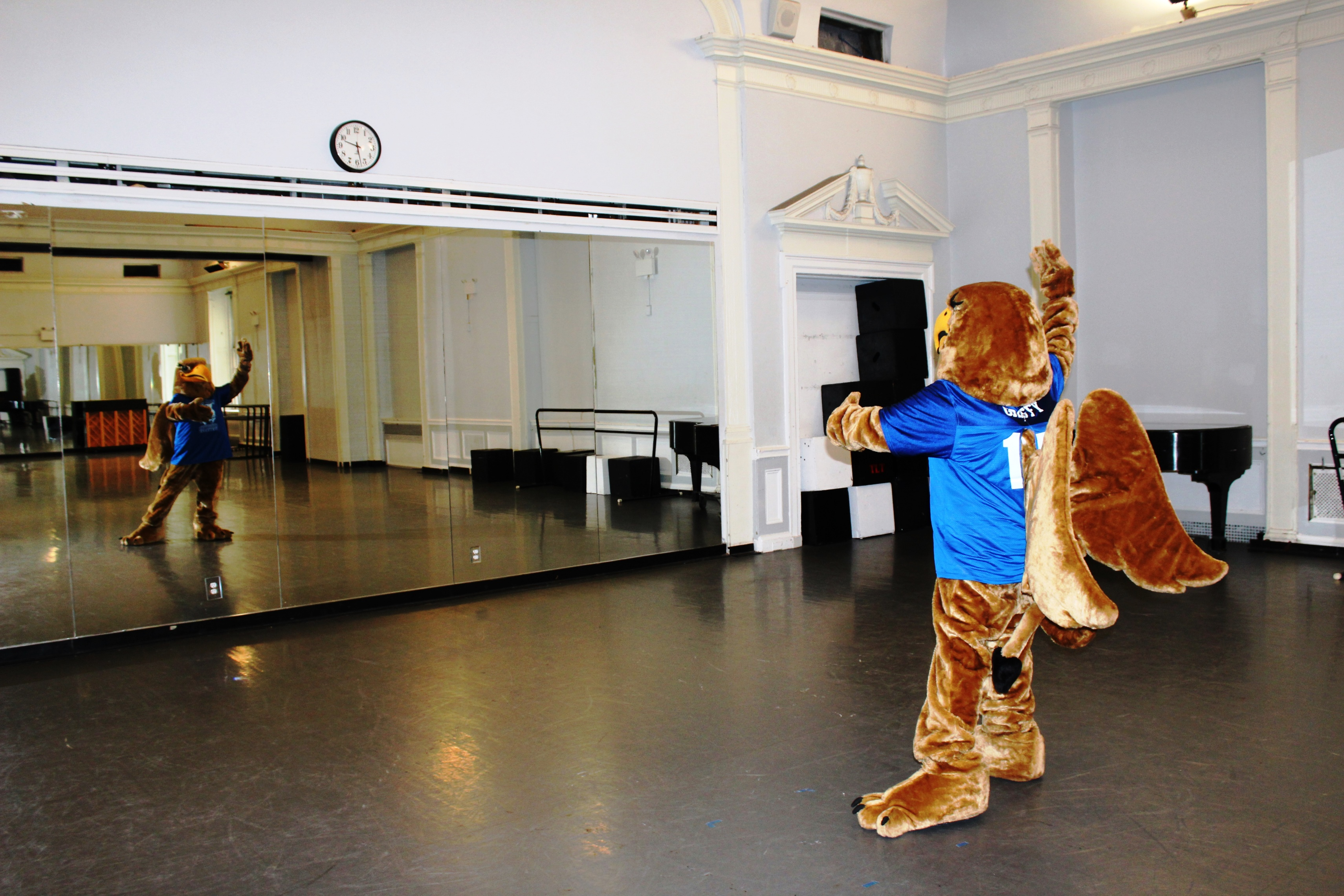 Griffy checking ballet position before mirror in Great Hall