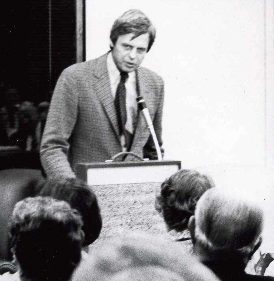 George Plimpton speaking to an audience.