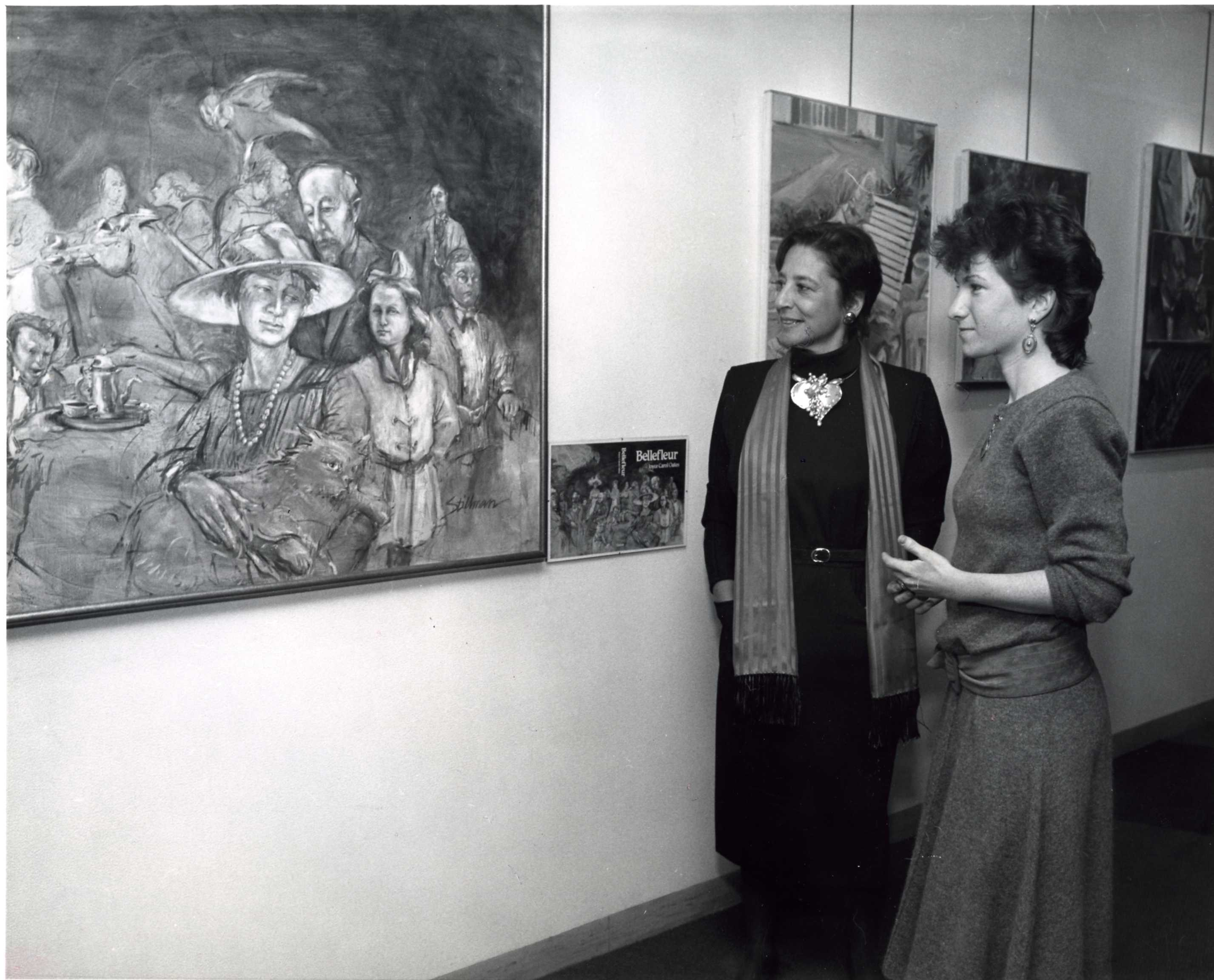 Two visitors studying a painting at MMC Art Gallery's opening night in 1985