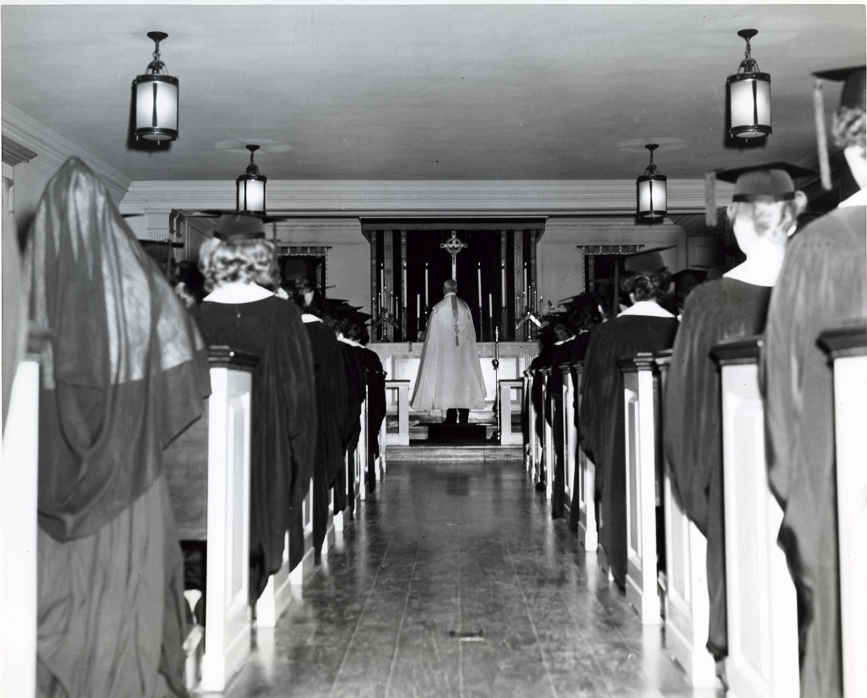 MMC Juniors receive their class rings in the chapel, 1950