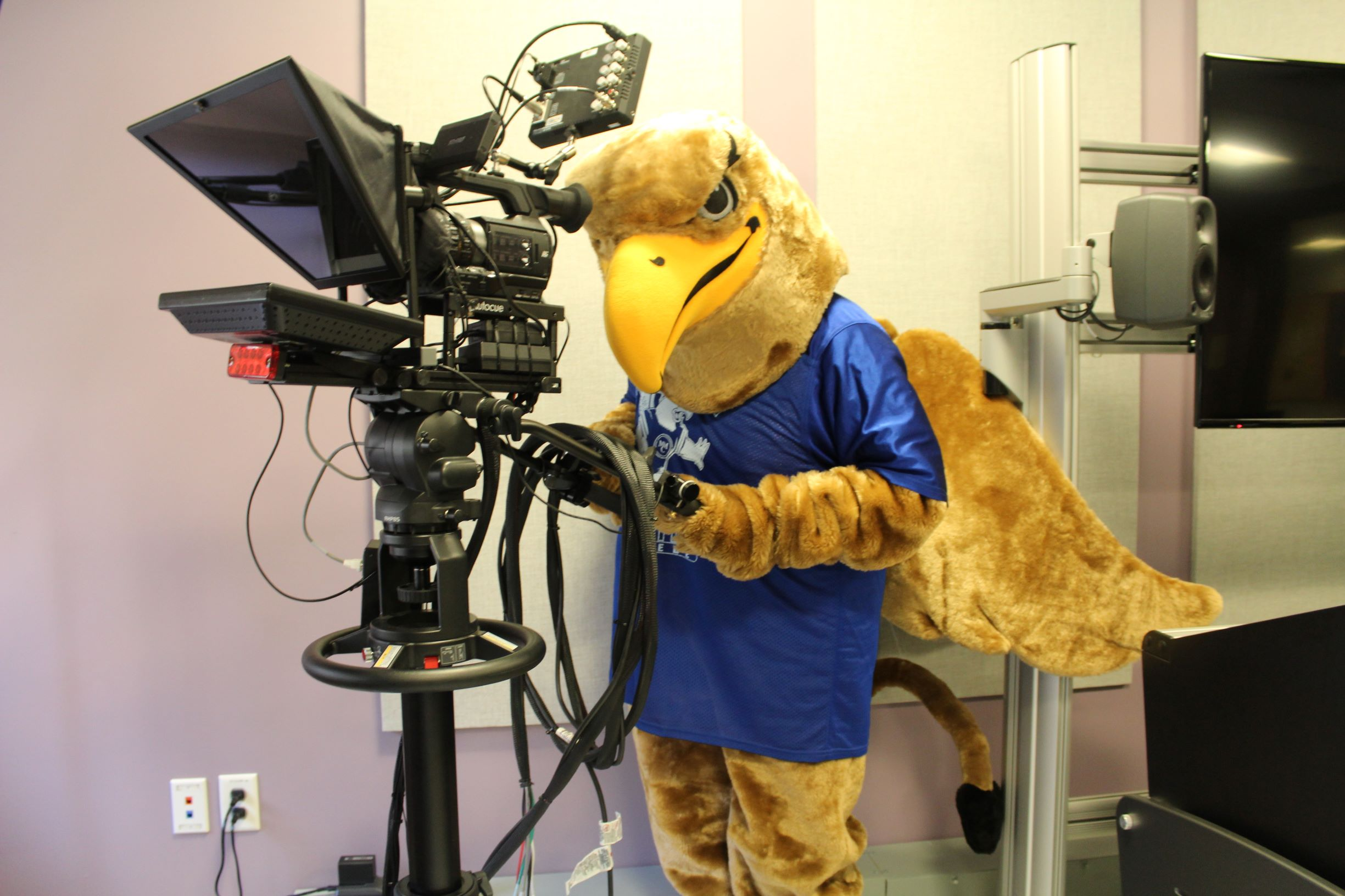 Griffy using camera in fifth-floor production room
