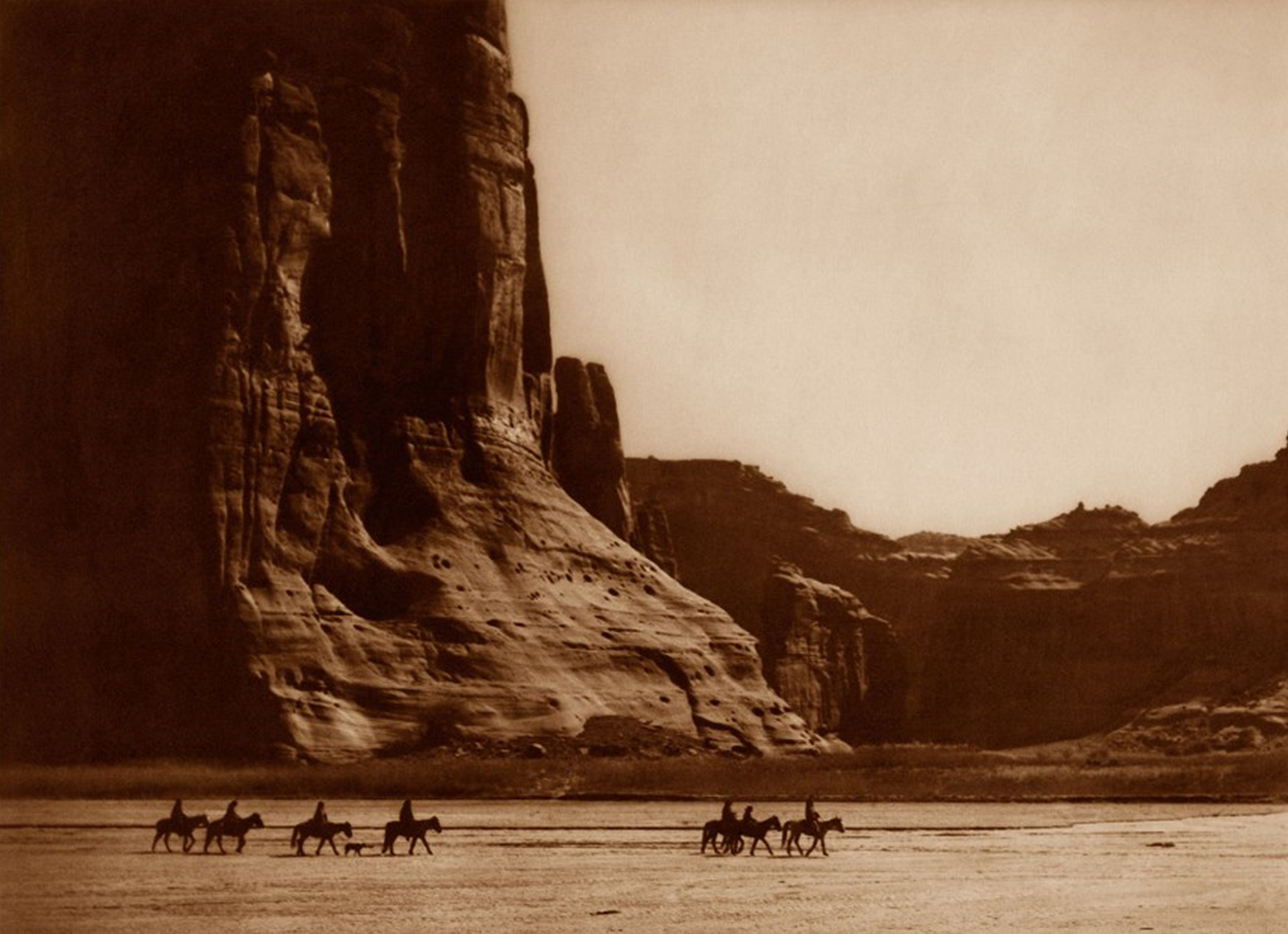 Navajo People Ride Horses by Arizonas Canyon de Chelly (Edward S. Curtis, 1904)
