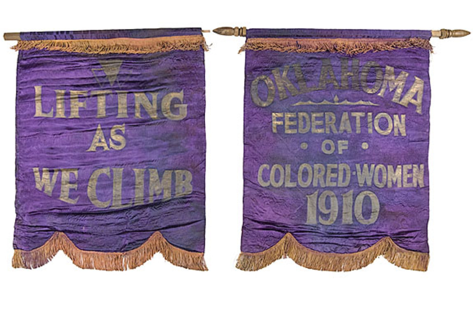 Purple Banners with gold trim and text. Text reads,