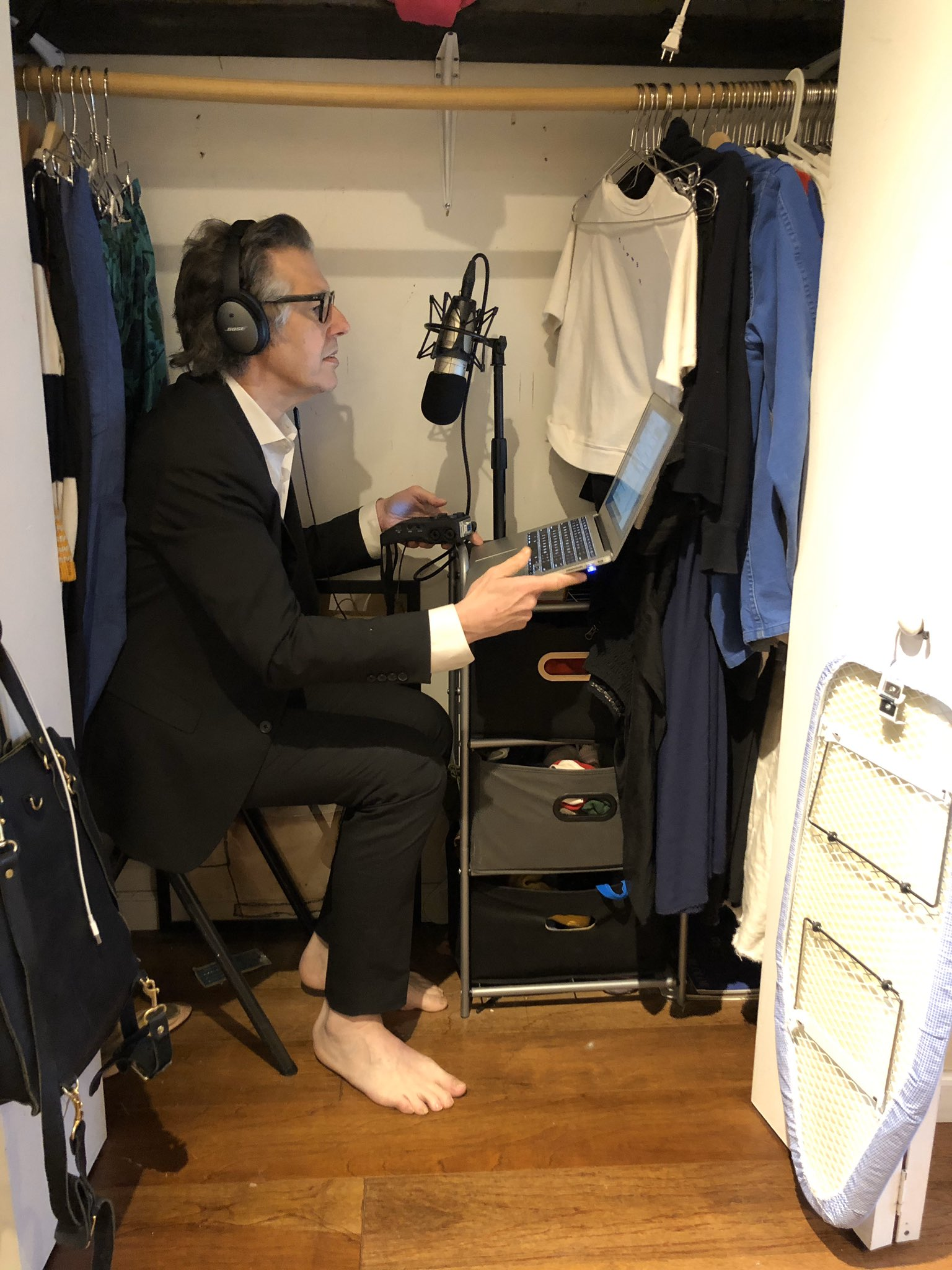Ira Glass of This American Life records his narration in a closet.