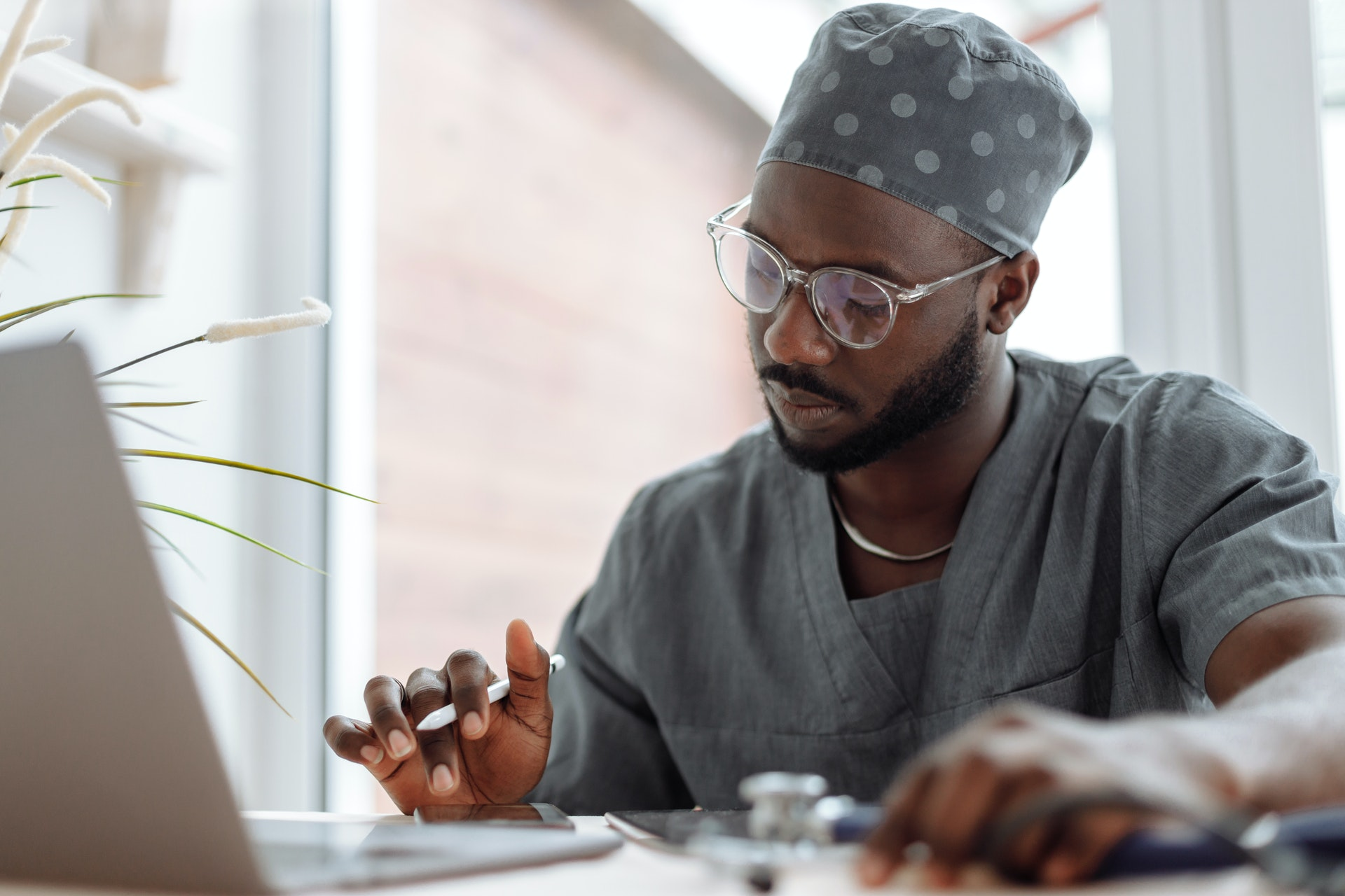 Image of a doctor working on a computer
