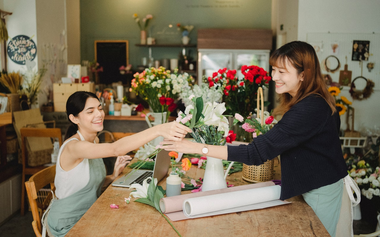 Image of two women working in a flower shop
