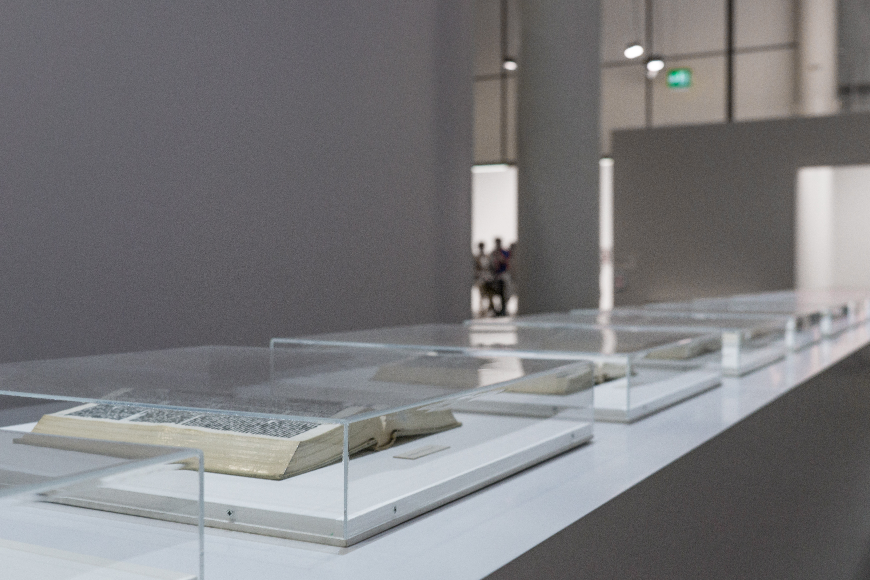 Books in plexiglass display cases