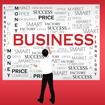 Man in front of a board with the word business and other business-related words