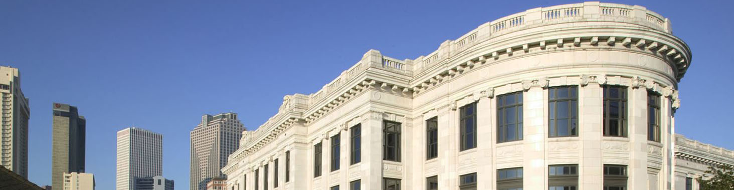 Image of the upper floors of the Chief Justice Pascal F. Calogero, Jr. Courthouse at 400 Royal Street with the New Orleans skyline framing the building.