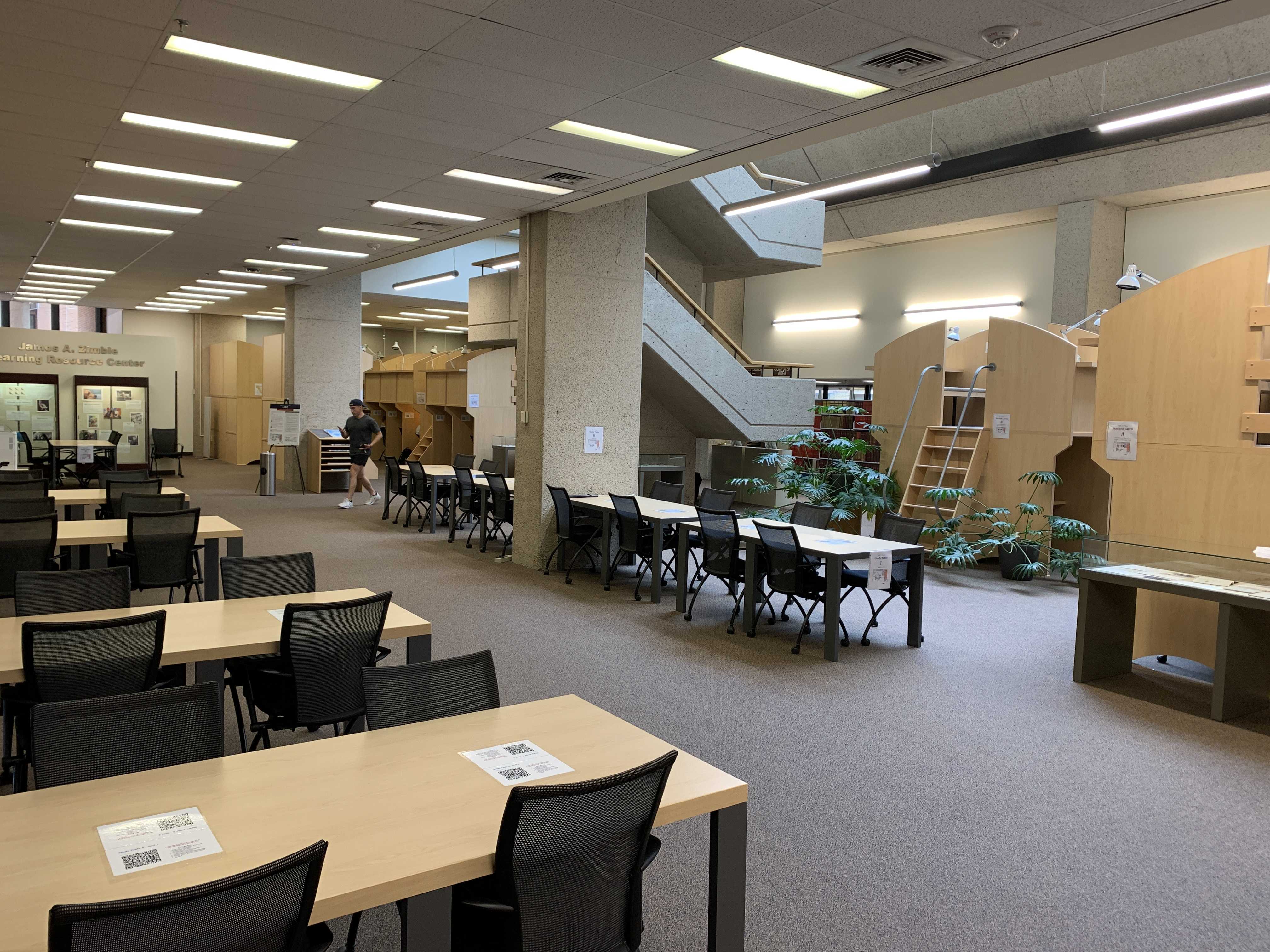 A view of the first floor of the LRC, showing study tables and carrels.