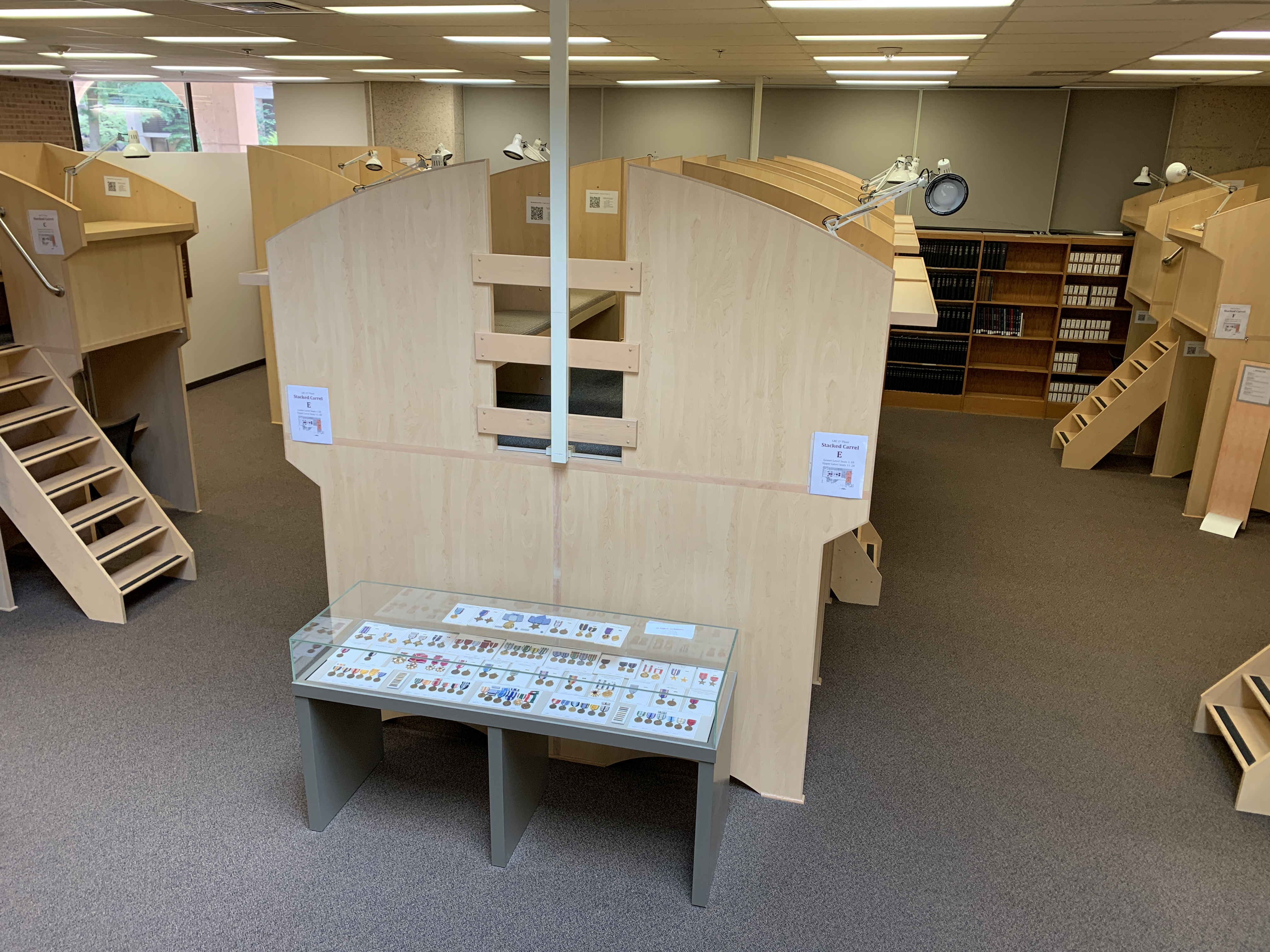 An overhead view of the first floor study carrels and the medal display case.
