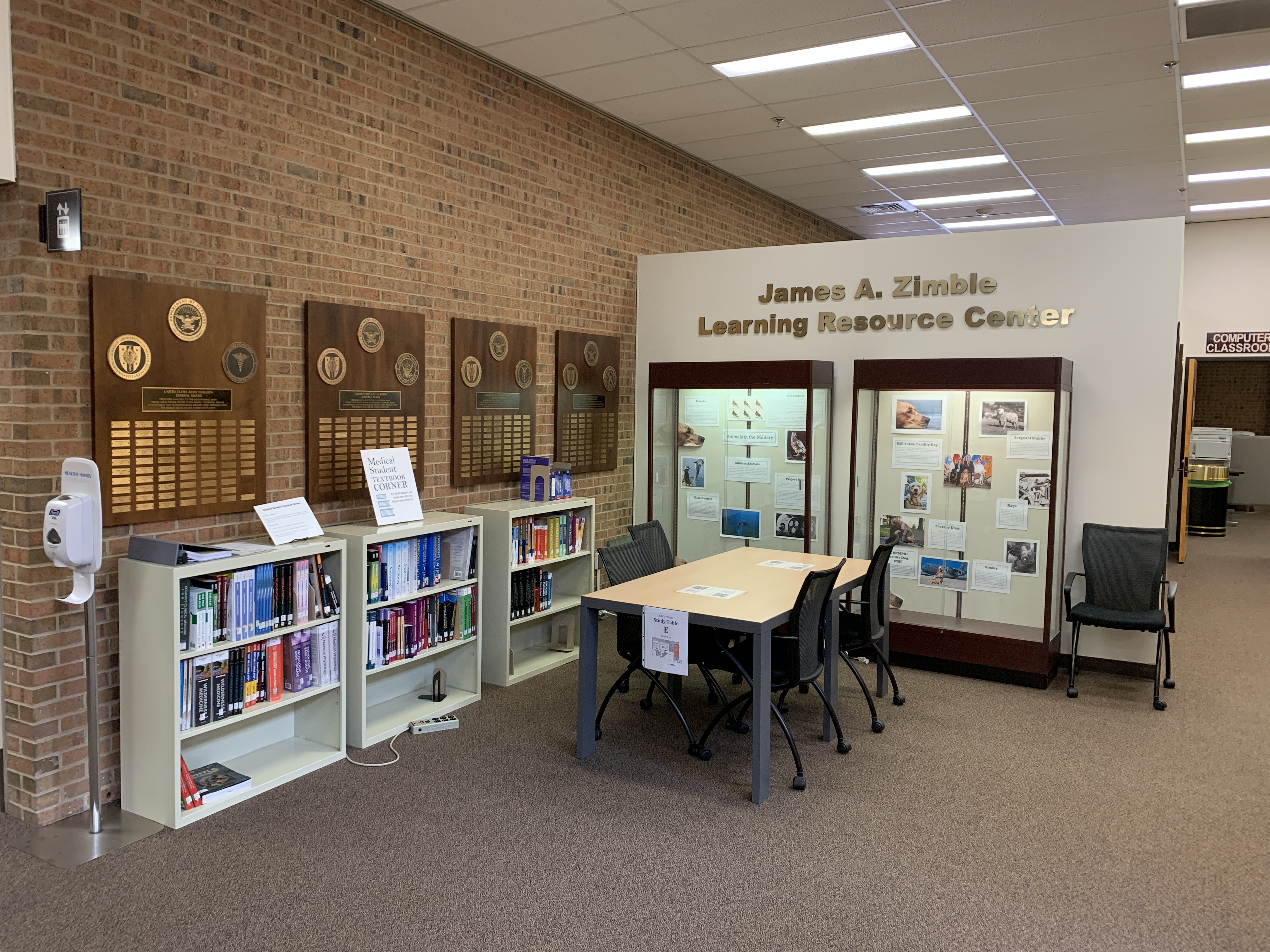 A group study table and the LRC display cases.