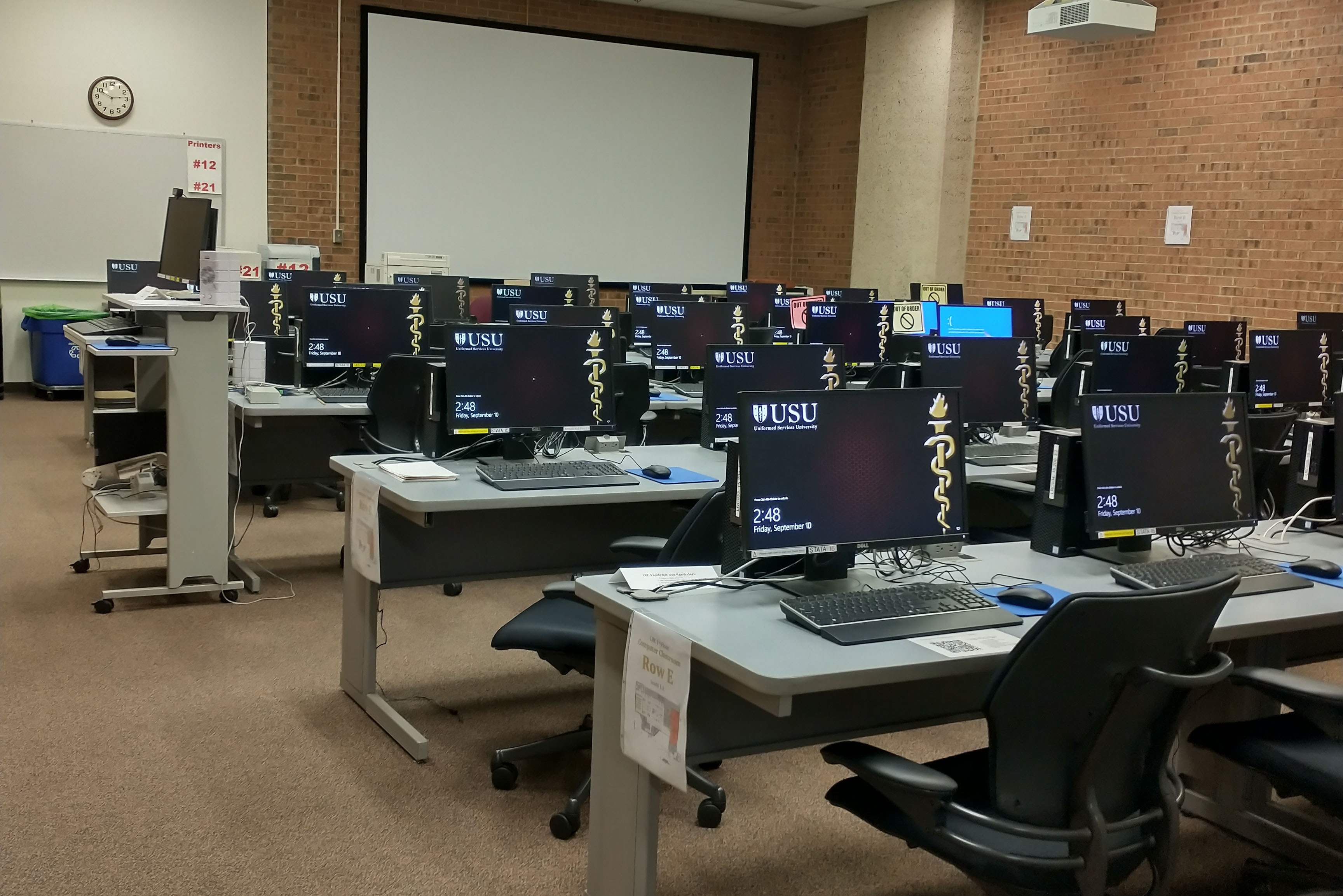 A view from the back of the LRC Computer Classroom, showing rows of computers.