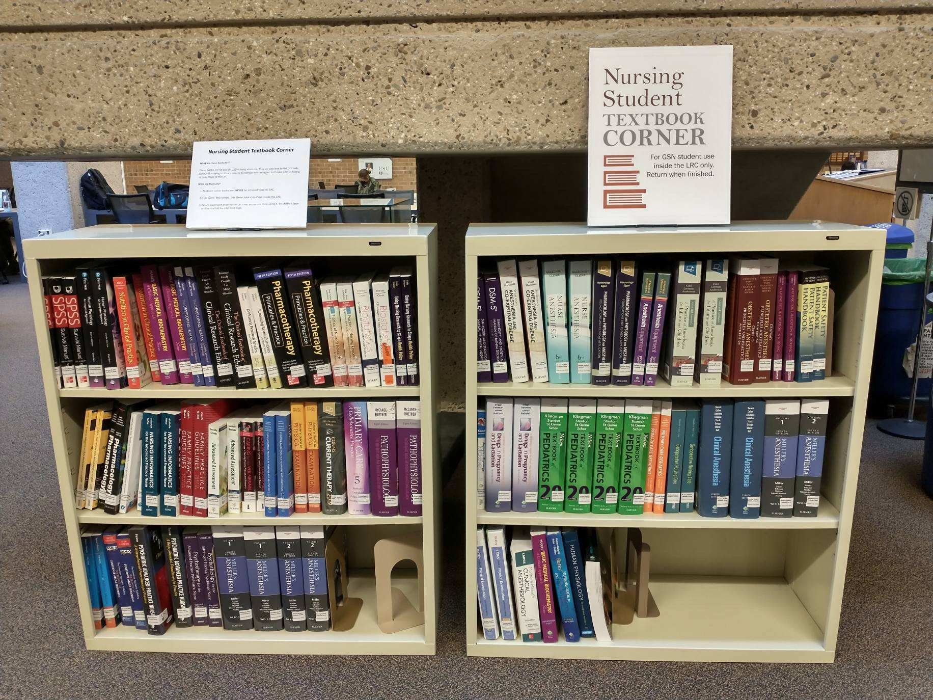 A bookshelf of textbooks for medical and nursing students.
