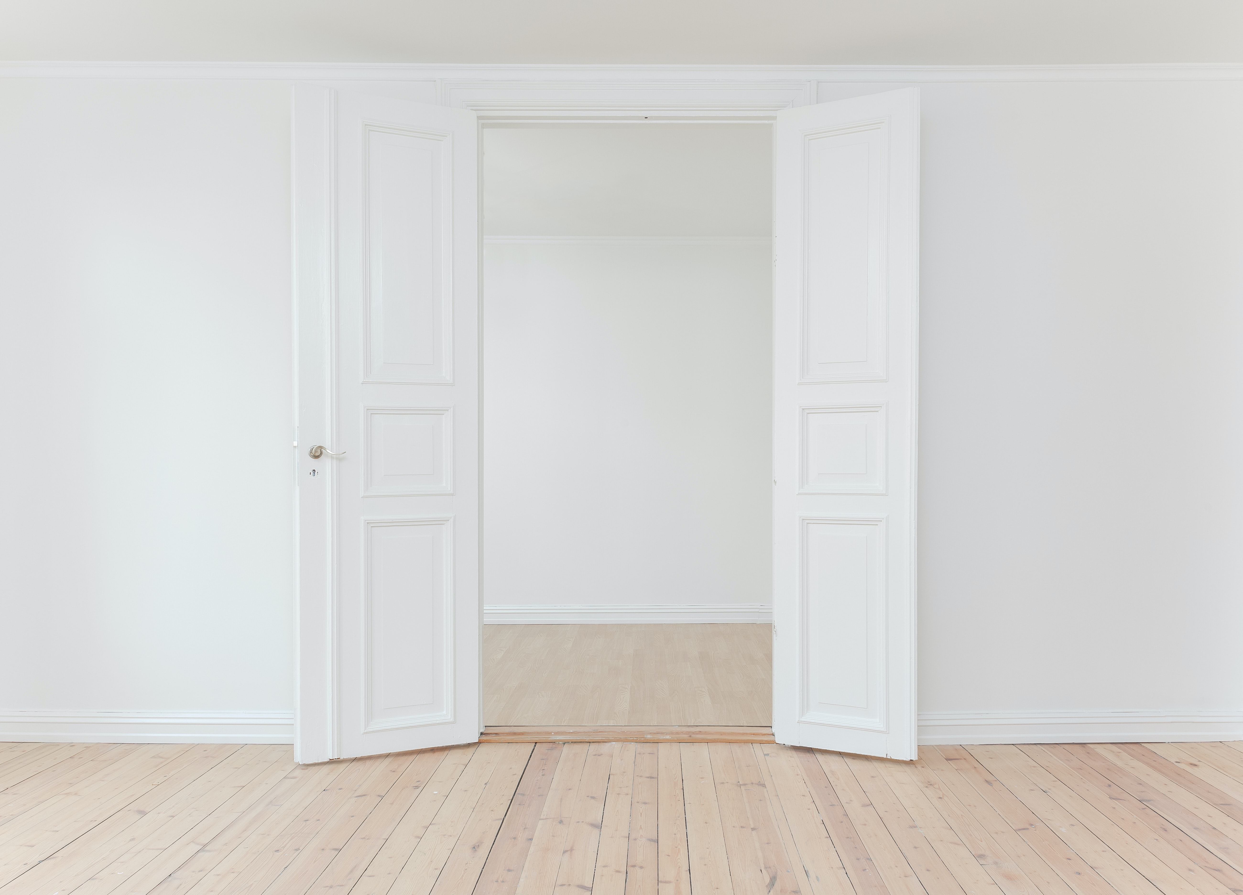 Picture of doors in a white room.