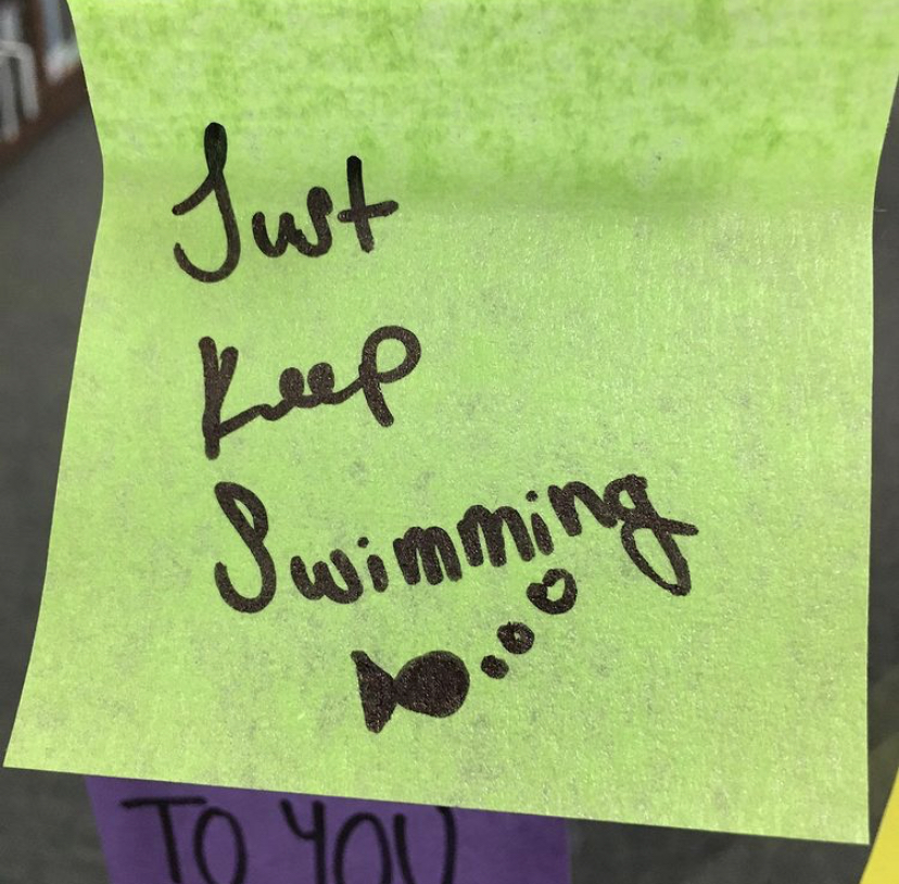 Image of post-it note with text Just Keep Swimming