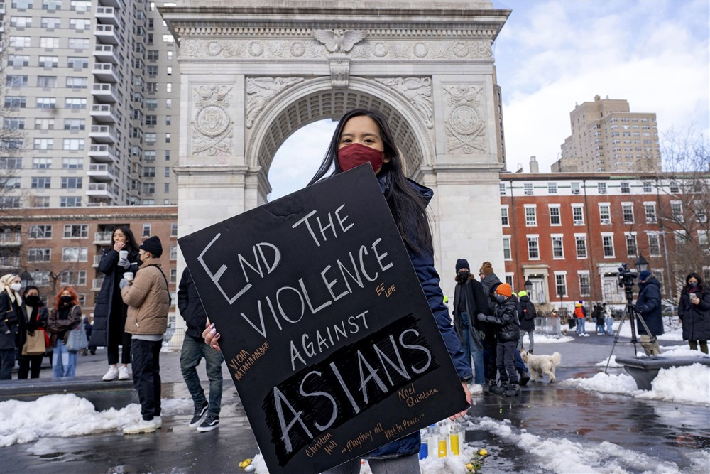 A woman holds a sign at the End The Violence Towards Asians rally in Washington Square Park on Feb. 20, 2021, in New York. Ron Adar/SOPA Images / Sipa USA via AP file
