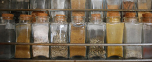 Photo of a row of unlabeled spice jars