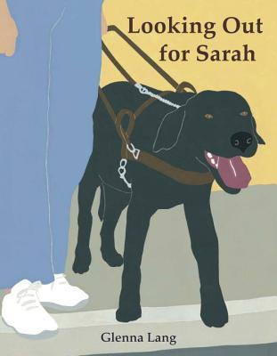 Book cover of Looking Out for Sarah. A black labrador dog in a guide dog harness is held by its owner.