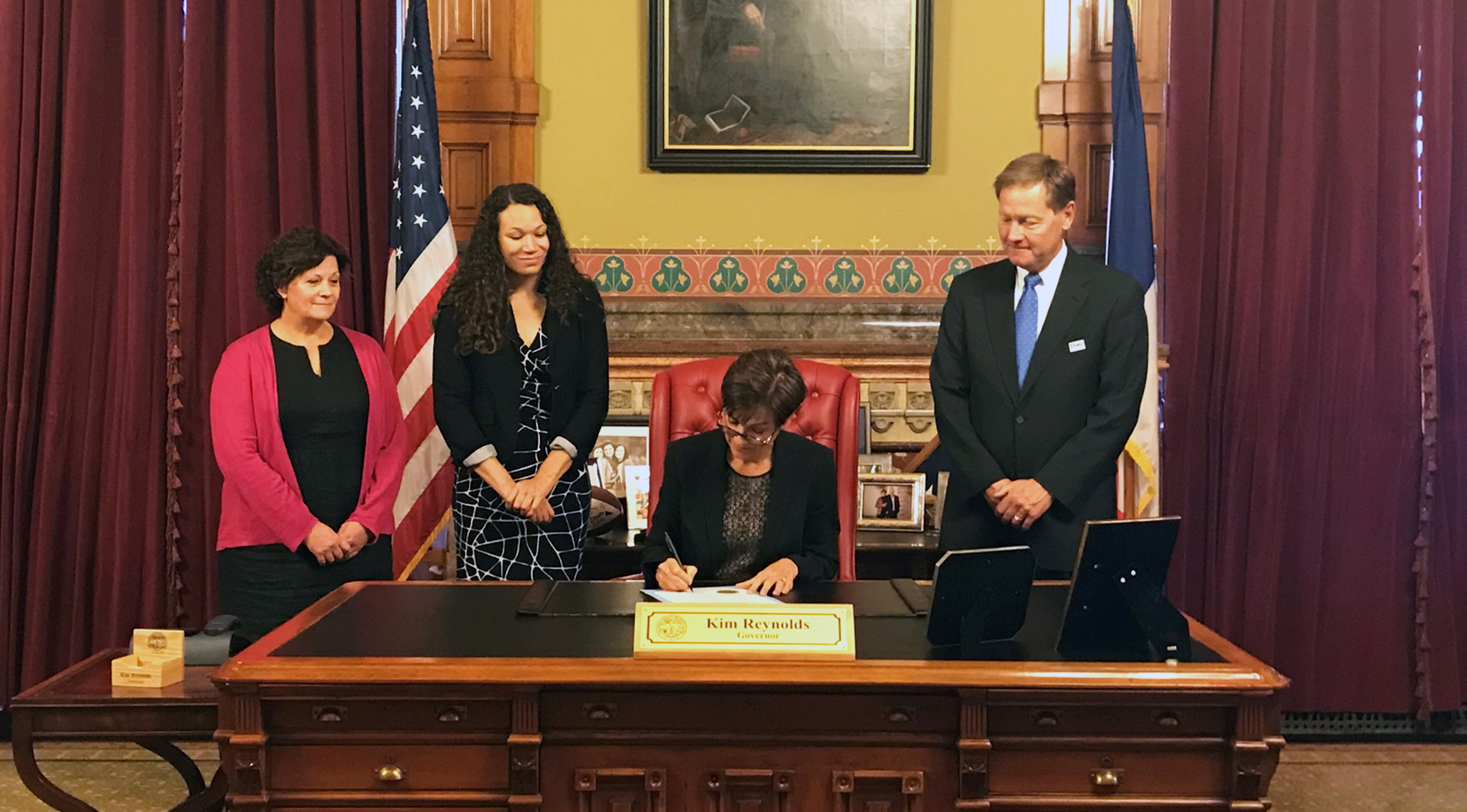 Iowa Gov. Kim Reynolds with Drake Law School personnel after signing a proclamation commemorating the Clark decision.